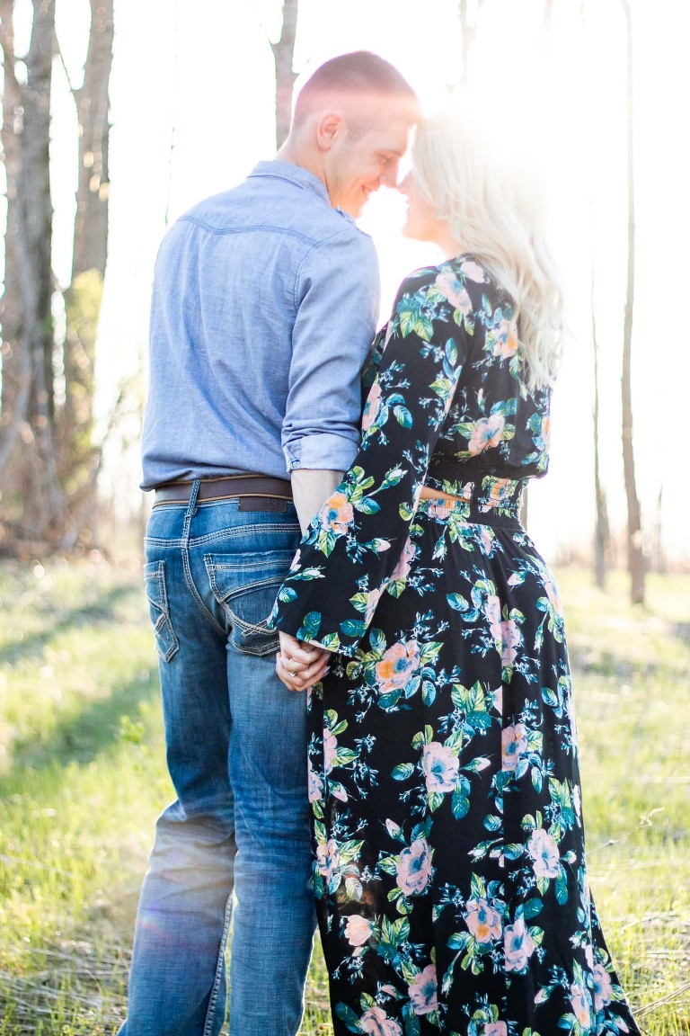 Couple Engagement Portrait Session in a field. Candid and Love-filled Images. Sarah Lisle Photography.